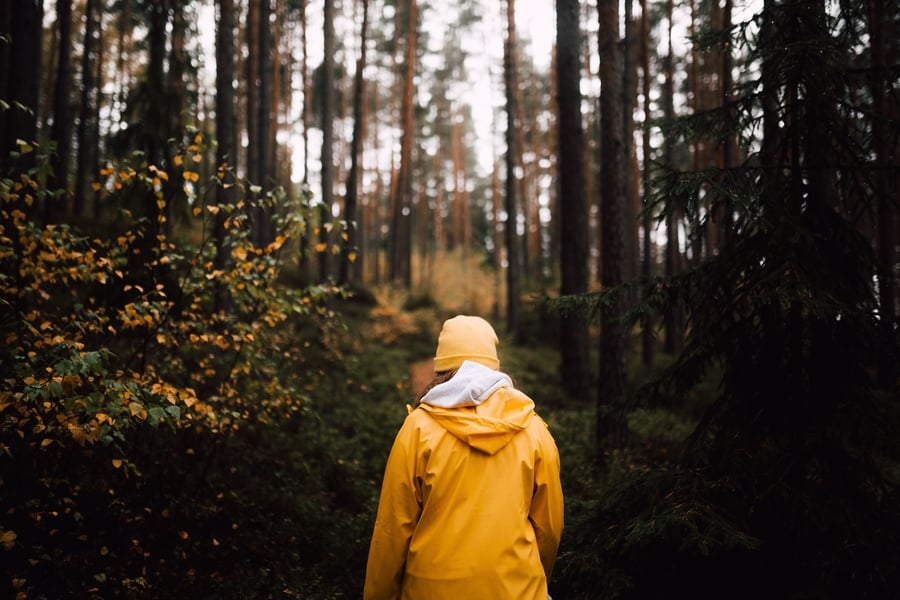 woman in the yellow raincoat