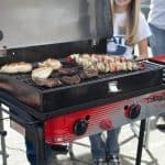 Camp Chef Big Gas Grill with meat