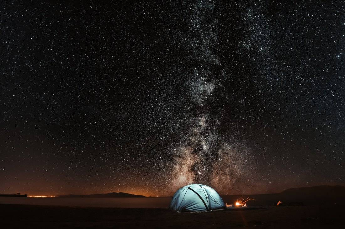 blue tent under the night sky and milky way